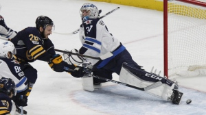Buffalo Sabres forward Zemgus Girgensons (28) puts the puck past Winnipeg Jets goalie Connor Hellebuyck (37) during the third period of an NHL hockey game, Saturday, Jan. 7, 2017, in Buffalo, N.Y. (AP Photo/Jeffrey T. Barnes)
