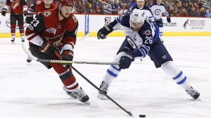 Arizona Coyotes defenseman Oliver Ekman-Larsson (23) battles with Winnipeg Jets right wing Blake Wheeler (26) for the puck during the second period of an NHL hockey game Friday, Jan. 13, 2017, in Glendale, Ariz. (AP Photo/Ross D. Franklin)