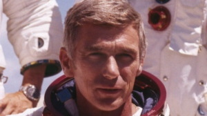 FILE - In an undated file photo provided by NASA, US Navy Commander and Astronaut for the upcoming Apollo 17, Eugene Cernan, is pictured in his space suit. NASA announced that former astronaut Cernan, the last man to walk on the moon, died Monday, Jan. 16, 2017, surrounded by his family. He was 82. (NASA via AP)