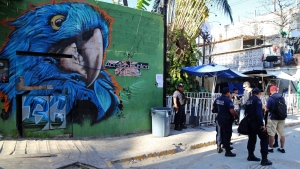 Police guard the entrance of the Blue Parrot nightclub in Playa del Carmen, Mexico, Monday, Jan. 16, 2017. A deadly shooting occurred in the early morning hours outside the nightclub while it was hosting part of the BPM electronic music festival, according to police. (AP Photo)
