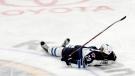 Winnipeg Jets forward Patrik Laine lays on the ice after being hit during the third period of an NHL hockey game against the Buffalo Sabres on Jan. 7. (Source: Jeffrey T. Barnes/AP)