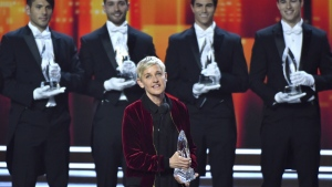 Ellen DeGeneres, winner of the awards for favourite animated movie voice, favourite daytime TV host, and favourite comedic collaboration, speaks on stage at the People's Choice Awards at the Microsoft Theater in Los Angeles on Wednesday, Jan. 18, 2017.  (Vince Bucci / Invision)