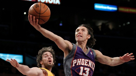 Phoenix Suns guard Steve Nash shoots as Los Angeles Lakers forward Pau Gasol, of Spain, defends during the second half of Game 1 of the NBA basketball Western Conference finals Monday, May 17, 2010, in Los Angeles. (AP Photo/Chris Carlson)