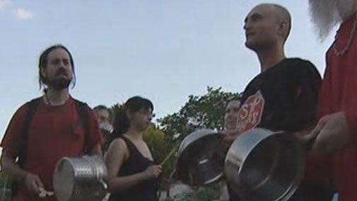 Winnipeg protesters bang pots and pans as part of Casserole Night.