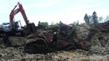 RCMP said the stolen tractor was located buried in a pile of manure in the RM of Fisher, southwest of Fisher Branch.