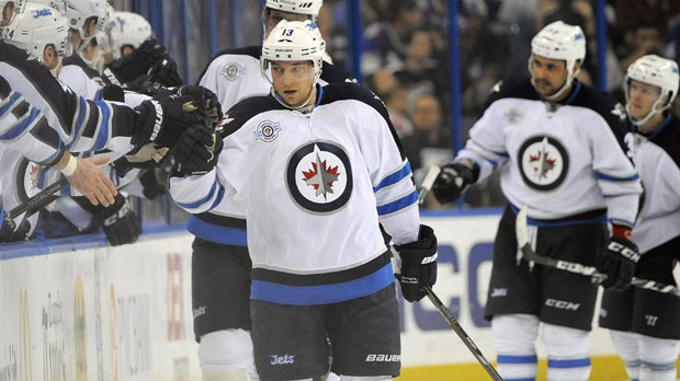 Winnipeg Jet Kyle Wellwood, center, celebrates with teammates. (AP File Photo / Brian Blanco)