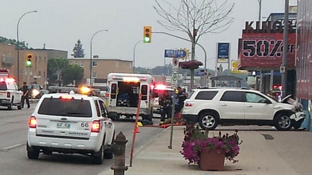 Police have closed off the intersection of Portage Avenue and Berry Street after a serious crash sent this SUV sailing into a nearby business. (Photo courtesy of Shaun McLeod)
