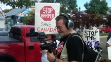 Protesters picket the arrival of Prime Minister Stephen Harper in Gimli Thursday morning.