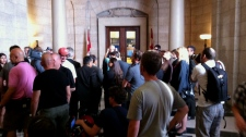 A fake media scrum is set up at the Manitoba legislature on set of the Jack Layton biopic.