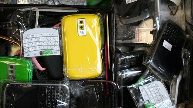 Officers said a variety of knock-off cellphone components were seized on Aug. 14, 2012 from shops in Winnipeg. (image courtesy RCMP federal enforcement section)