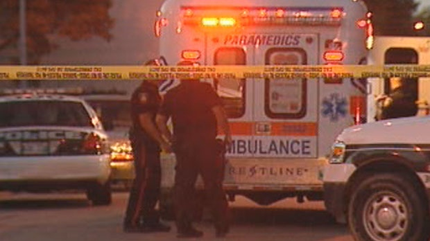 Winnipeg police and emergency crews were on scene after a teen was shot in a back lane between Alfred and Aberdeen avenues on Aug. 16, 2012.