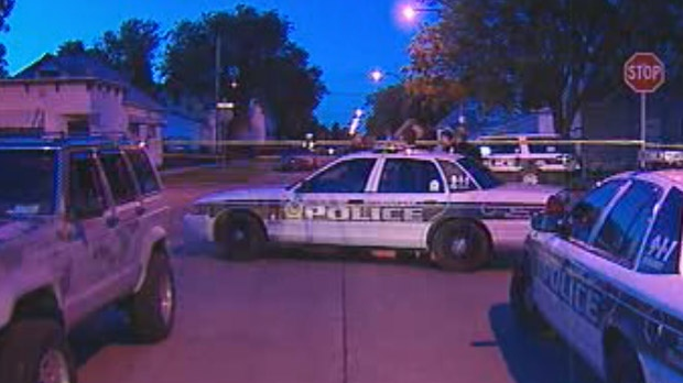 Winnipeg police investigate after a male youth was shot in a back lane on Aug. 16 following a home invasion in the 800 block of Aberdeen Avenue.