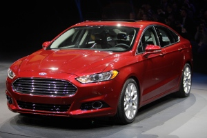 The 2013 Ford Fusion is introduced during the North American International Auto Show in Detroit, Monday, Jan. 9, 2012. (AP Photo/Carlos Osorio)