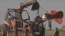 Crews pull wreckage of Manitou plane crash