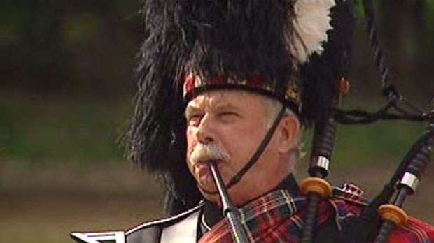 A man plays bagpipes during the first night of the 2012 Barge Festival at The Forks.