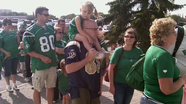 Blue Bombers and Roughriders fans line up outside Mosaic Stadium in Regina on Saturday for pre-game day festivities.