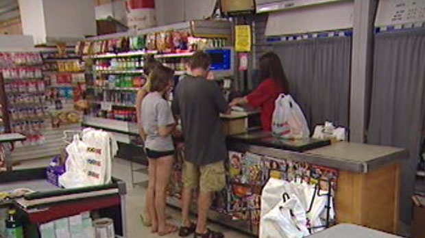 Shoppers visit the Food Fare on Portage Avenue in Winnipeg Sunday.
