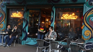 In this Oct. 31, 2011 file photo customers are seen outside the coffee shop The Green House in Amsterdam, Netherlands. (AP / Peter Dejong, File)