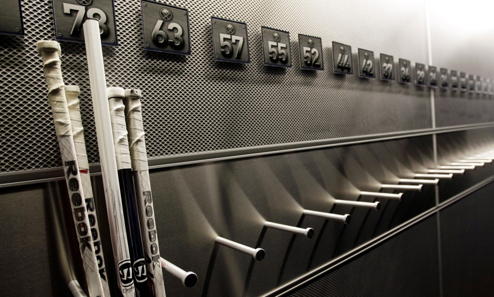 A nearly empty hockey stick rack in the Buffalo Sabres locker room is shown at the First Niagara Center, home of the Buffalo Sabres NHL hockey team, in Buffalo, N.Y., Tuesday, Sept. 25, 2012. (AP / David Duprey)