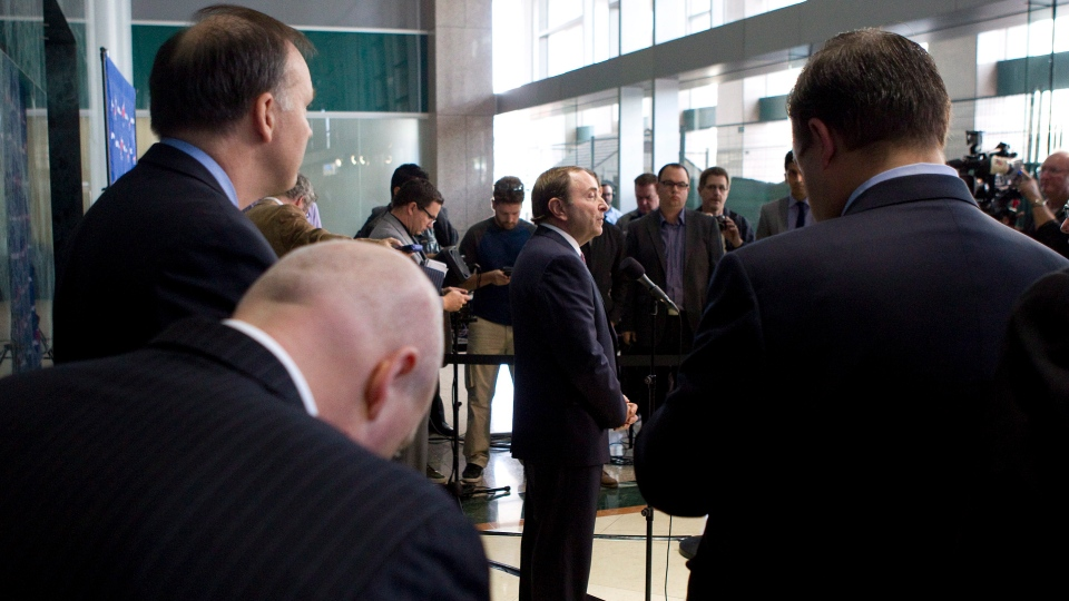 NHL commissioner Gary Bettman (centre) speaks to journalists after collective bargaining talks in Toronto on Tuesday, Oct. 16, 2012. The NHL has presented a new offer to the players that it hopes will end the lockout and allow for a full 82-game season. (THE CANADIAN PRESS/Chris Young)